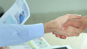 Close-up view of a handshake while two successful stock video footage
