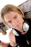 Close up view of handsome guy with skateboard. On an isolated background Stock Photo