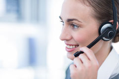 Close up view of happy businesswoman with headset Royalty Free Stock Photos