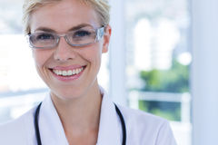 Close up view of happy female doctor looking at camera Stock Images