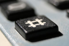 Close up view of a hashtag button. Close up macro view of hashtag button of a telephone Royalty Free Stock Photography