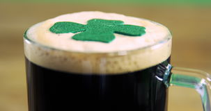 Close up view of head of a pint with shamerock for st patricks day stock video