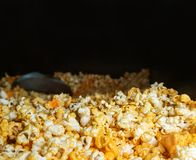 Close up view of heaped yellow isolated cheese pop corn stock photography