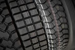 Close up view on heavy trucks and tractors new wheel tires surface. Different pattern and type tires for automotive industry comme. Close up view on heavy trucks stock photography