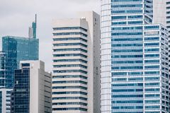Close up view of high modern office and business building in downtown Singapore. A Close up view of high modern office and business building in downtown stock photo