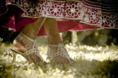 Close up view of Hindu bride's painted feet dancing in garden Stock Photography