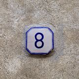 Number 8 eight on blue and white ceramic sign. stock photography