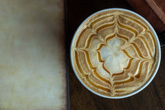 Close up view of hot cappuccino coffee with vintage paper Stock Photos