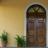 Close up view of house facade , close wooden door and potted plants. Close up view of house facade - close wooden door and potted plants royalty free stock image