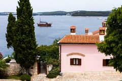 Close-up view of houses with tiled roofs and the sea in the European old town of Rovinj, Croatia. royalty free stock image