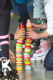 Close up view of human hands building plastic color cones on rollerskating playground Royalty Free Stock Photos