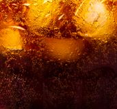 Close up view of the ice cubes in cola background.  Royalty Free Stock Photos