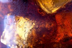 Close up view of the ice cubes in cola. Background Royalty Free Stock Photography