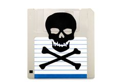 Infected computer floppy disk. Close up view of a infected computer floppy disk isolated on a white background. Conceptual image with skull and bones Stock Photos