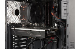 Close up view inside open midi tower computer case Royalty Free Stock Photo