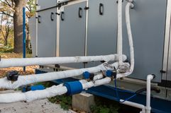Close-up view of the insulated refrigerant pipelines with thermal expansion valves and automation sensors connected to the industr. View of the insulated Stock Photo