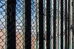 Close-Up View of International Border Fence With Tijuana Beach. Close-up view of the border fence separating San Diego, California and Tijuana, Mexico, with a Royalty Free Stock Images