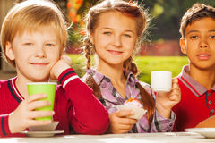 Close up view of international kids drinking tea royalty free stock images