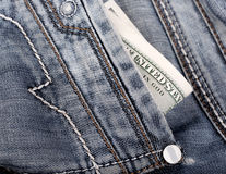 Close up view on the jeans pocket with banknotes Royalty Free Stock Photo