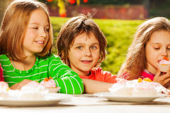 Close up view of kids sit outside at table Royalty Free Stock Photography