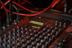 Close up view of knobs and sliders of light and sound board console at a concert theater royalty free stock photography