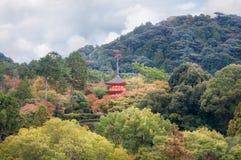 Koyasu Pagoda View on Mount Otawa in autumn at Kiyomizu garden in Kyoto. Close up view of Koyasu Pagoda from Kiyomizu-dera temple`s famous veranda surrounded by royalty free stock image