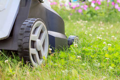 Close up view of lawn mower on green grass in the garden Stock Images
