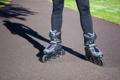 Close up view of legs in roller blades Stock Photos
