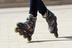 Close-up view of male legs in roller blades Stock Images