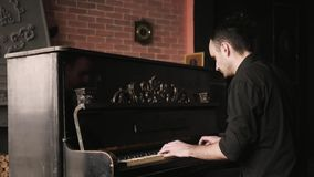 Close up view of pianist playing the piano in an old-fashioned house. stock video footage