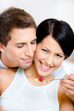 Close up view of man feeding his girlfriend Stock Photography