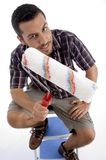 Close up view of man holding painting brush Royalty Free Stock Image