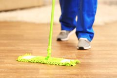 Close up view of man. Moping floor Stock Photography