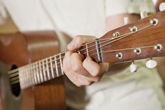 Close-up view of man's hand playing guitar Royalty Free Stock Photos
