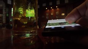 Close Up View of Man Using Samrtphone While Drinking Beer in Pub. Shot with a Sony a6300 fps29,97 4k stock video