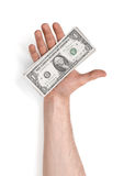 Close up view of a man's hand holding one dollar bills  on white background Stock Photography