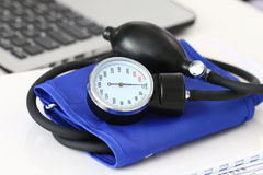 Close up view of manometer laying on medical doctor working tabl. Close up view of manometer laying on working table near laptop. Hospital workspace. Healthcare Royalty Free Stock Photo
