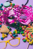 Close up view of masquerade masks and candies. On purple stock photos