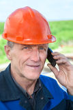 Close-up view of mature manual worker in hardhat calling on the phone Stock Images