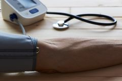 Close-up view of measure blood pressure of a man in clinic royalty free stock photography