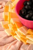 Close-up view of meat and cheese tray. Including turkey lunch meat, two kinds of cheese and olives stock photo