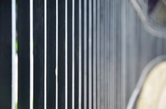 Close up view of a metal fence in perspective with blurred backgroun. D Stock Image