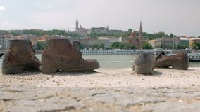 Close-up view on metal shoes on Danube Bank, Buda side is in background