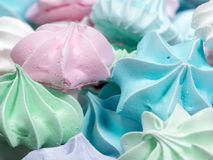 Close-up view of mini meringue cookies. Close-up view of white, red, green and blue mini meringue cookies Stock Photo