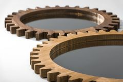 Close-up view of mirrors framed by wooden cogwheels Stock Photos