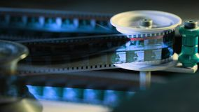 Close up view of 35mm cinema film in a movie theater