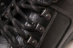 Man boot laces. Close up view of modern black man boot laces isolated on a white background Stock Images