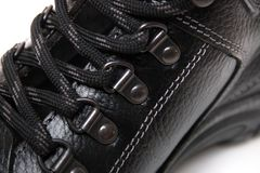 Man boot laces. Close up view of modern black man boot laces isolated on a white background Royalty Free Stock Photography