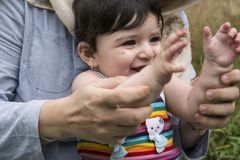 Close-up view of mother and little baby teaching to clap in outd. Oor field Royalty Free Stock Photo