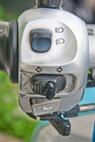 Close-up view of motorcycle handlebar controls Stock Image